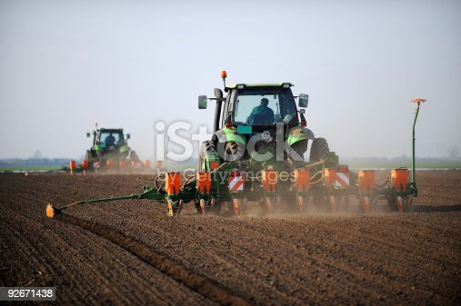 Seeding - tractors working on a field