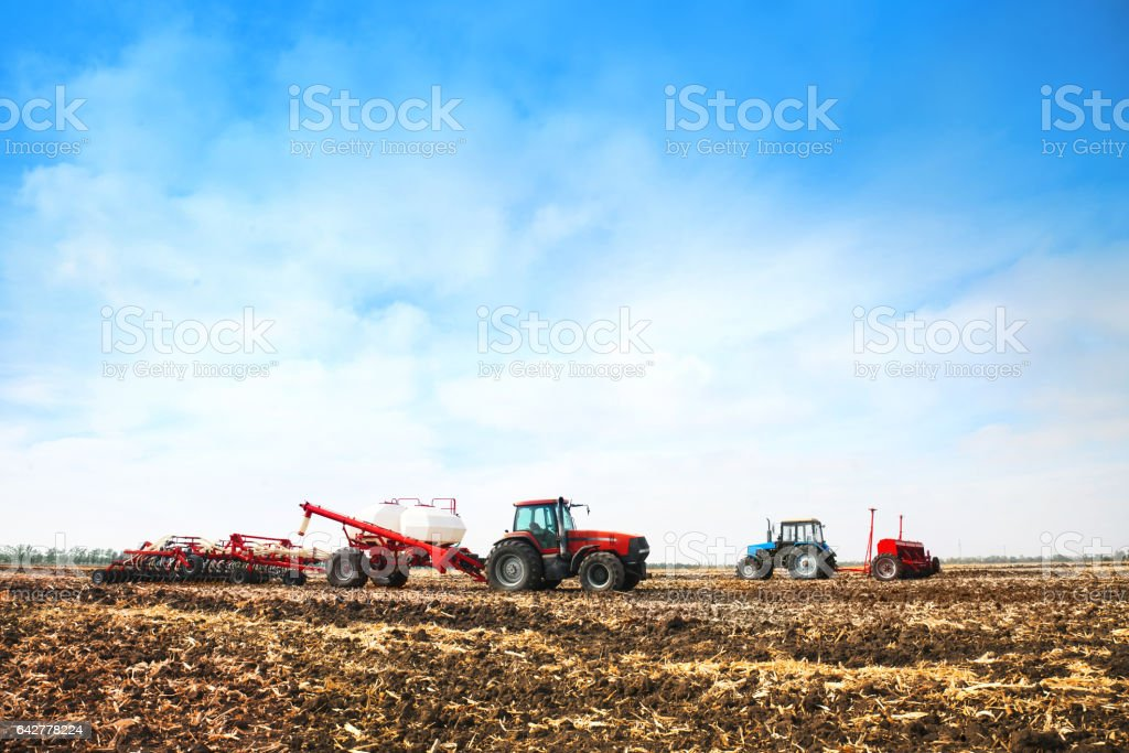 Tractors with tanks in the field. Agricultural machinery and farming. stock photo