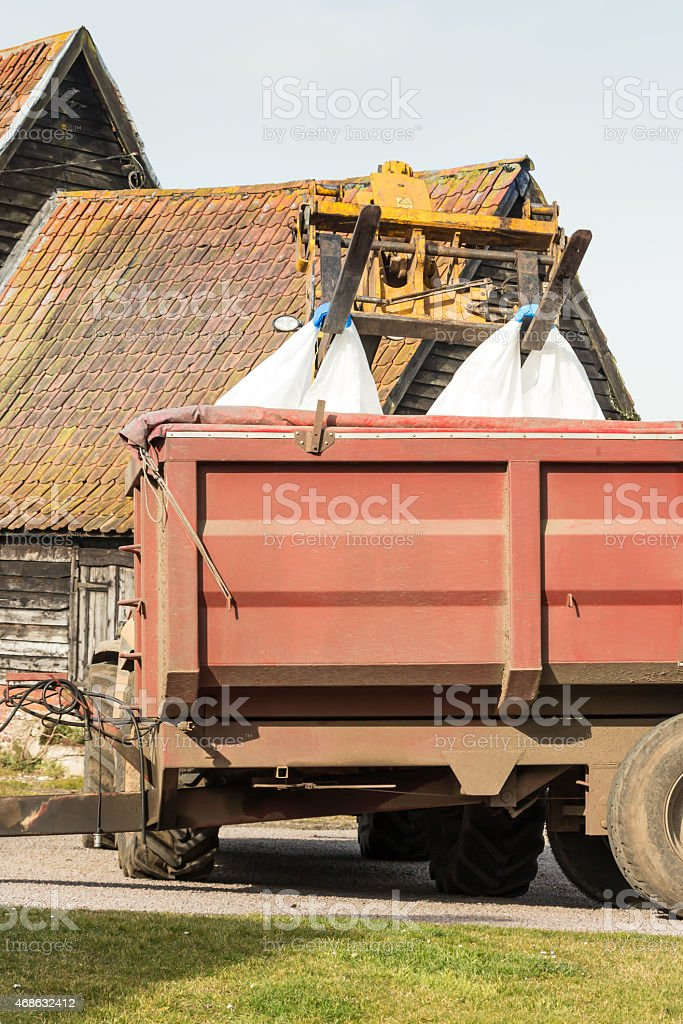 Tractors working in the farmyard stock photo