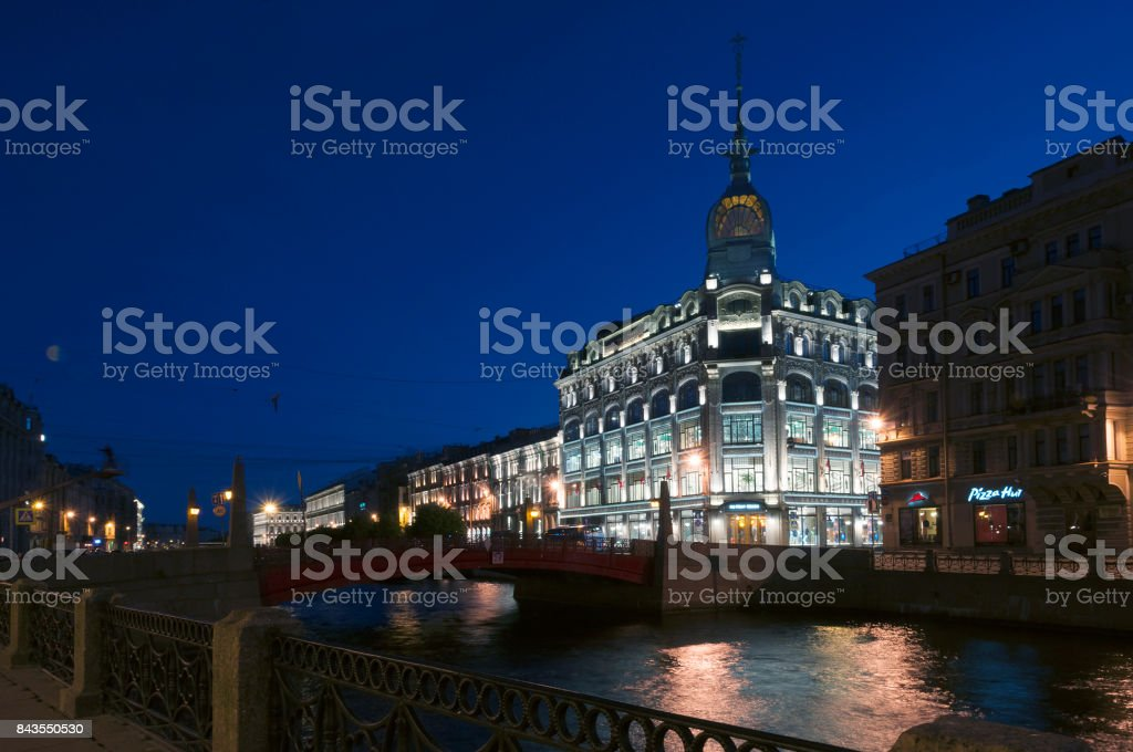 SAINT PETERSBURG, RUSSIA - July 2, 2017: Trade house 'Esders and Scheefhals' at night illumination, embankment of river Moika, St. Petersburg, Russia stock photo