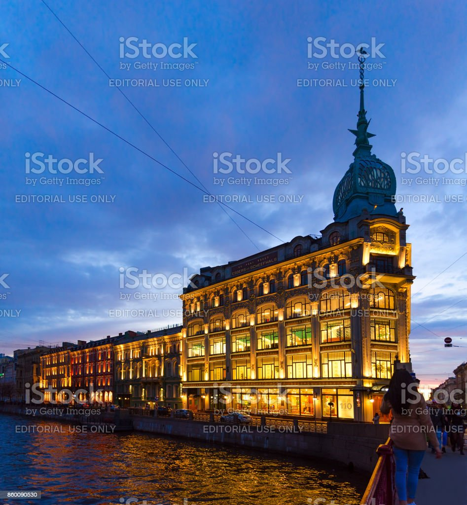 Trade house 'Esders and Scheefhals' in evening illumination, embankment of river Moika, St. Petersburg, Russia stock photo