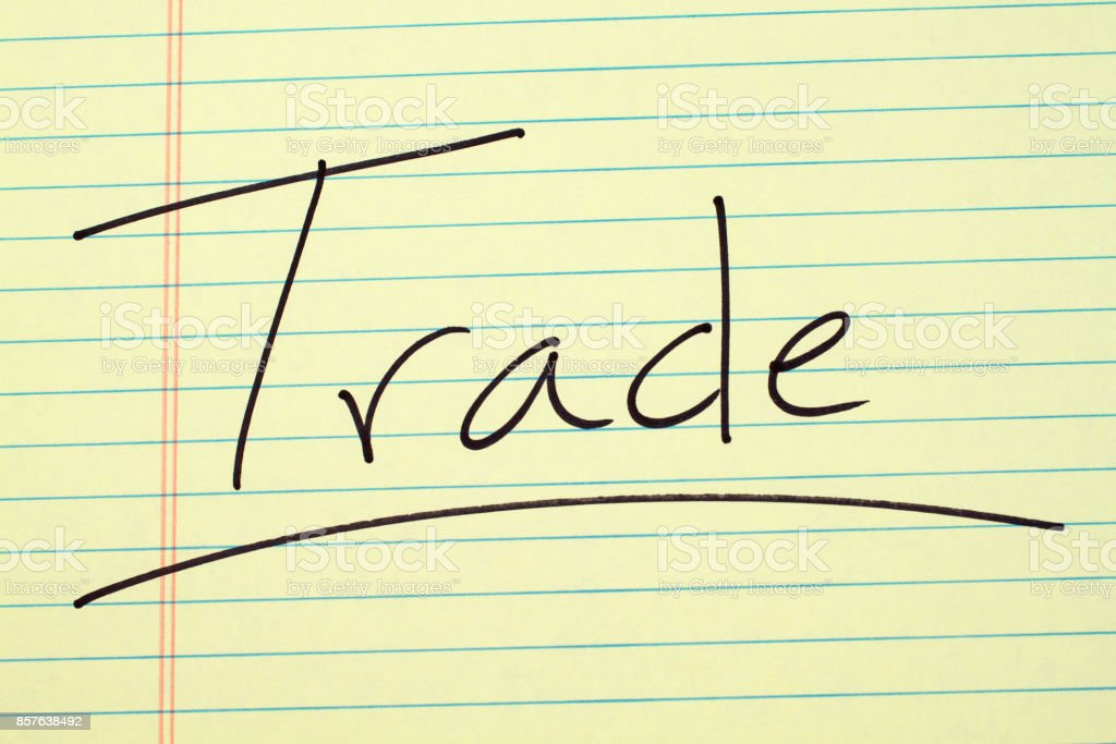 Trade On A Yellow Legal Pad stock photo