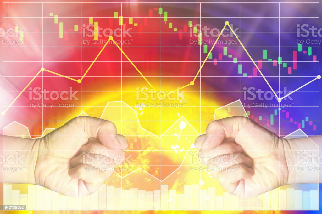 Trade war crisis problem between two big country cause global economic impact by dropping stock index market.The image shown two hands punch on heat graph background.Sun image furnished by NASA. stock photo