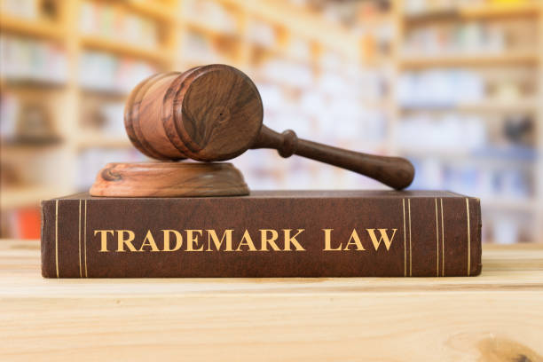 """trademark law Trademark law books and a judge gavel on desk in the library. concept of legal education.""""n intellectual property stock pictures, royalty-free photos & images"""