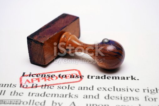 Close up of wooden stamp on Trademark license form
