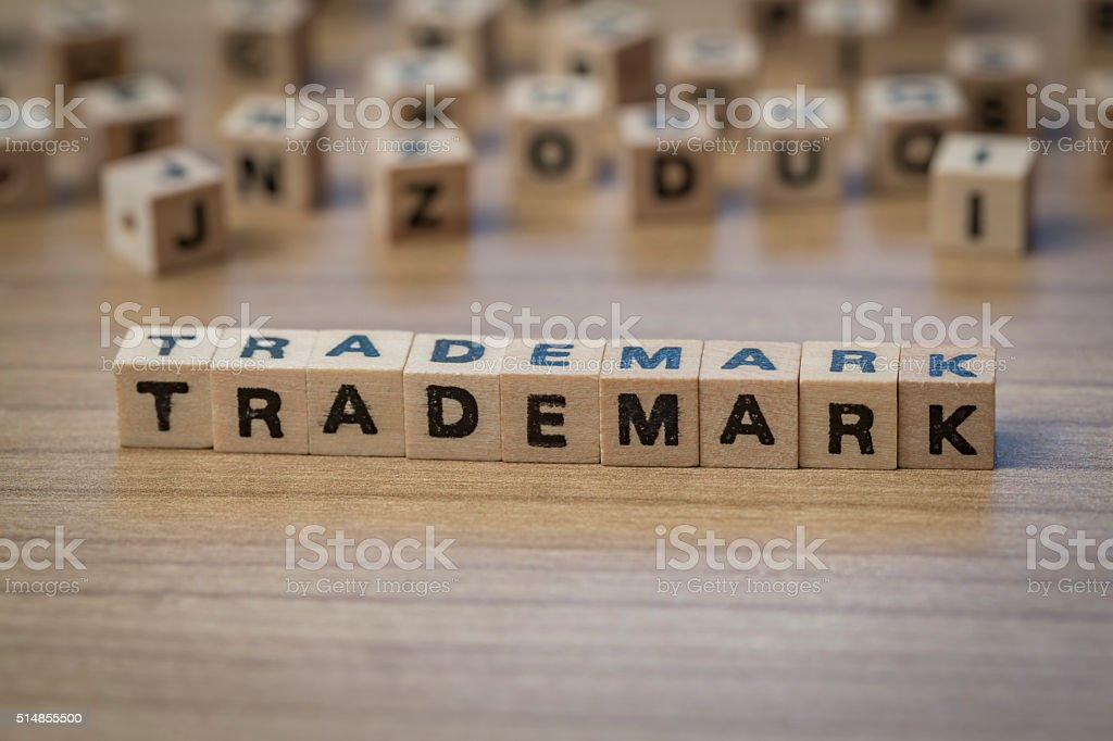 Trademark written in wooden cubes stock photo