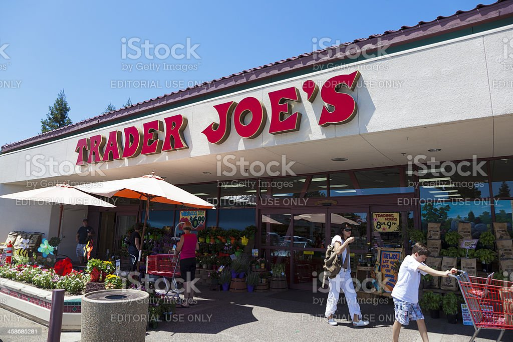 Trader Joe Store Fair Oaks, California, USA - July 23, 2011: Shoppers going in and out of Trader Joe's grocery store on a sunny summer day. Trader Joe's is a privately held chain of specialty grocery stores .The first Trader Joe's store opened in Pasadena, California in 1967 and today there are over 360 stores in 29 states. Blue Stock Photo