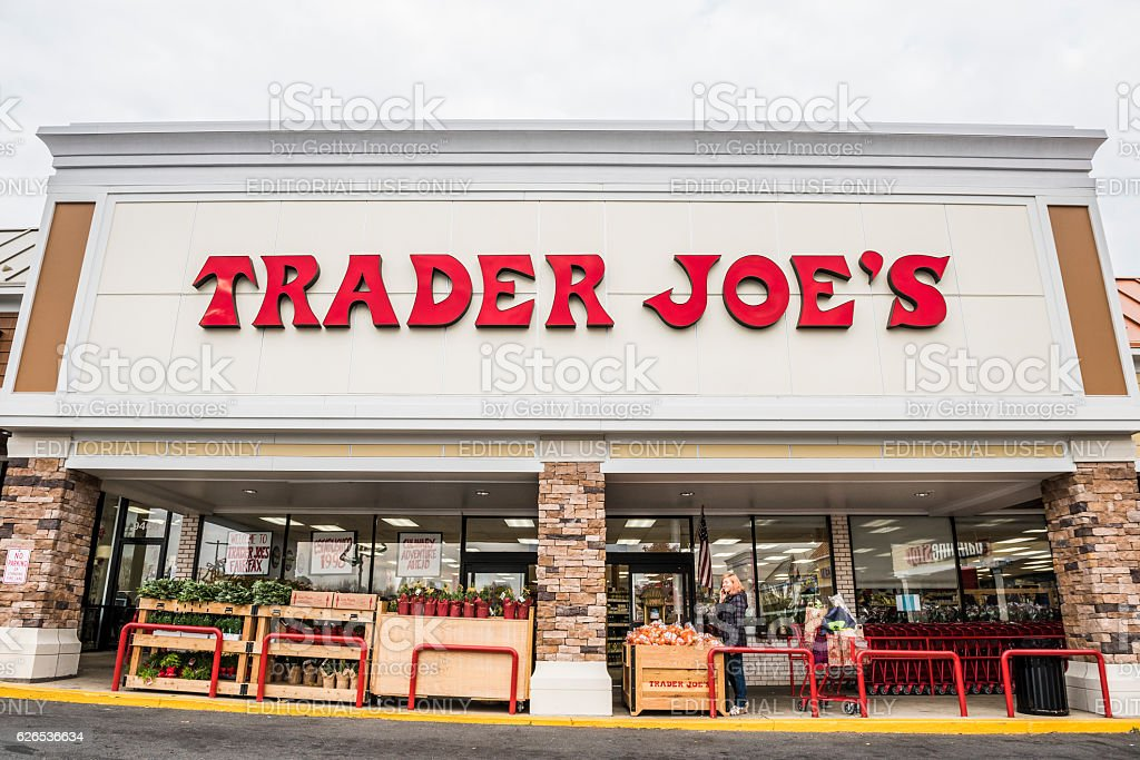Trader Joes grocery store facade with sign and items on display and...