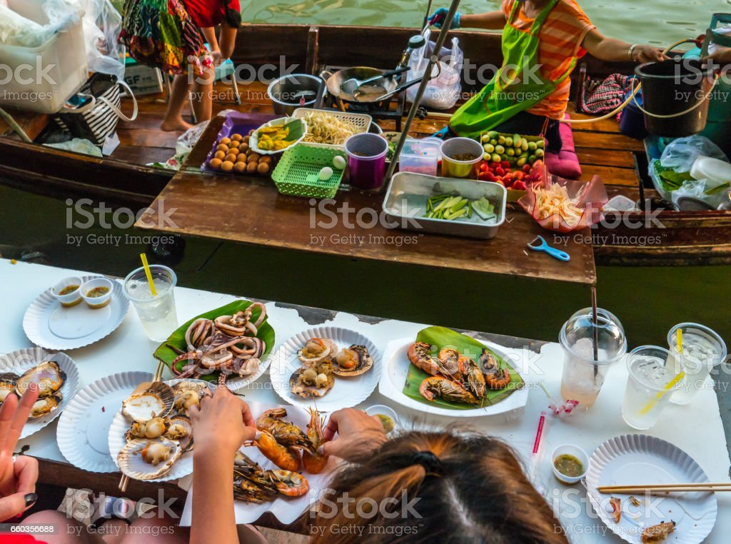 Trader's boats in a floating market in Thailand stock photo