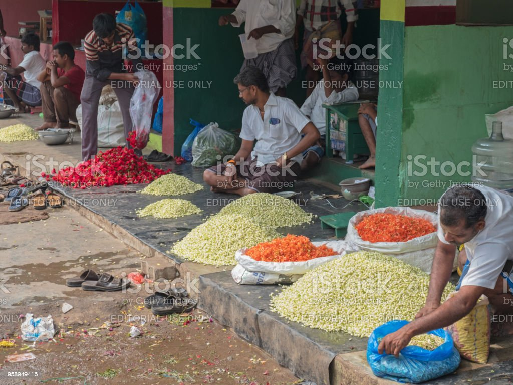 Traders in a flower market at Madurai stock photo