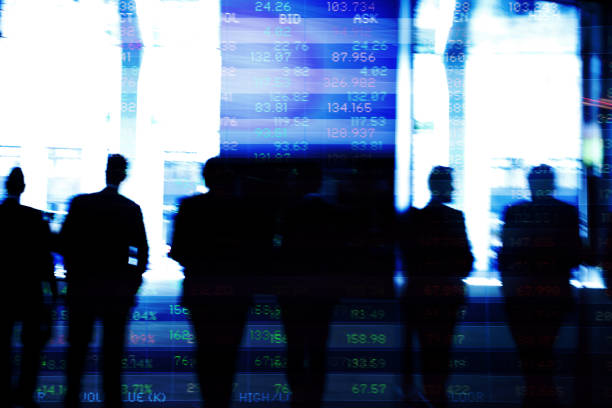 Traders in financial district with trading screen data. Abstract image of traders in financial district with trading screen data, light reflections and blurred movement. investor stock pictures, royalty-free photos & images