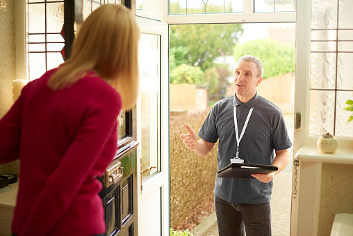 a tradesman or sales man call on a householder to ask if she needs his services