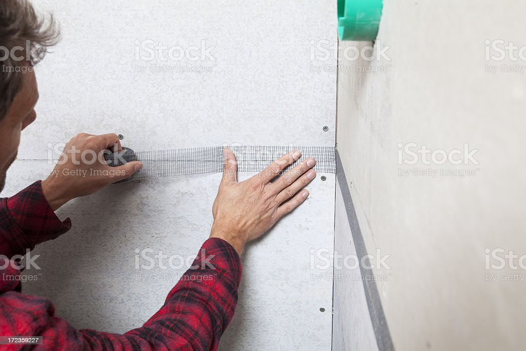 Tradesman Taping Wall Joints royalty-free stock photo