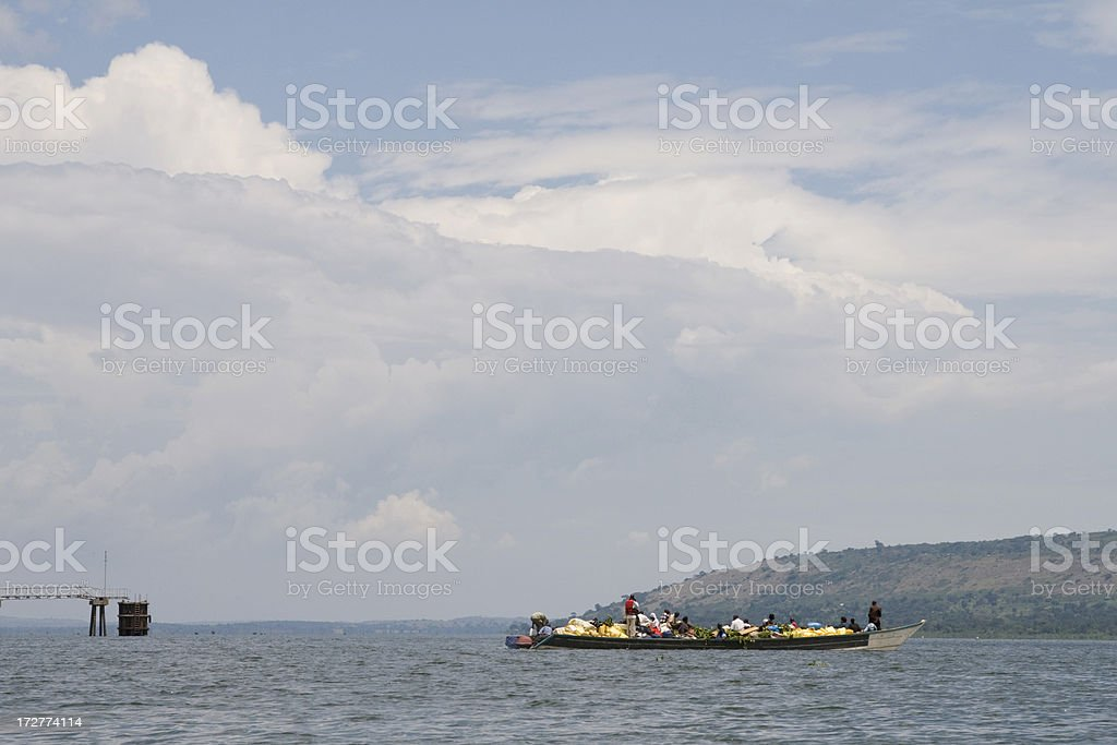Trading boat sailing out stock photo
