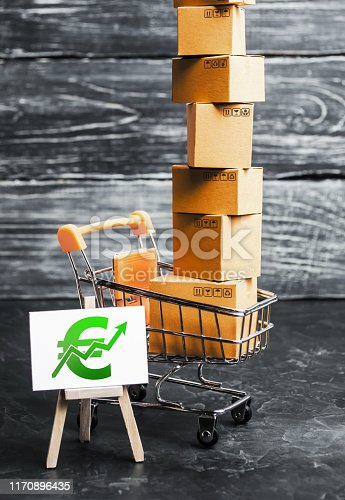 1155852718istockphoto Trading car with boxes and an easel with a green euro symbol. Positive trend. Advertising sale, marketing. Business strategy analysis. Shopping online. Growth and prosperity of the economy, surplus. 1170896435