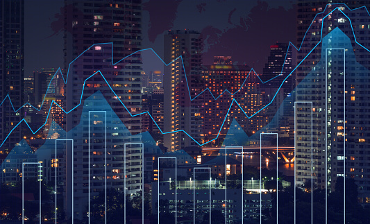 istock Trading graph on the cityscape at night and world map background,Business financial concept 815084424