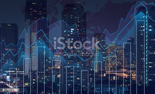 istock Trading graph on the cityscape at night and world map background,Business financial concept 817513462