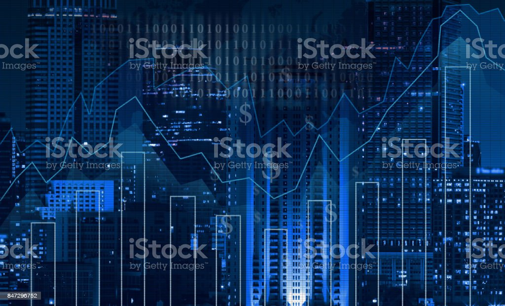 Trading graph on the cityscape at night and world map background,Business financial concept stock photo