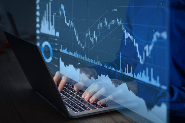 Trading on stock exchange market and investment strategy for financial assets with person using online software to analyze price statistics and trade from home at night to make profit stock photo