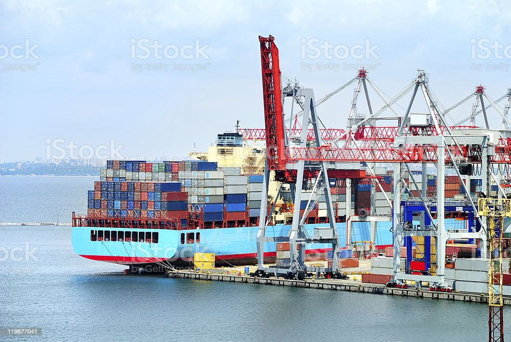 Trading seaport with cranes, cargoes and ship royalty-free stock photo