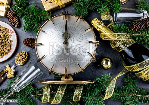 istock NEW YEARS EVE RITUAL. Tradition to eat spoon of lentil at midnigth. Holidey composition with vintage clock, lentil and Christmas decorations 881283072
