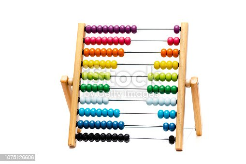 Traditional abacus with colorful wooden beads on white background, mathematics toy