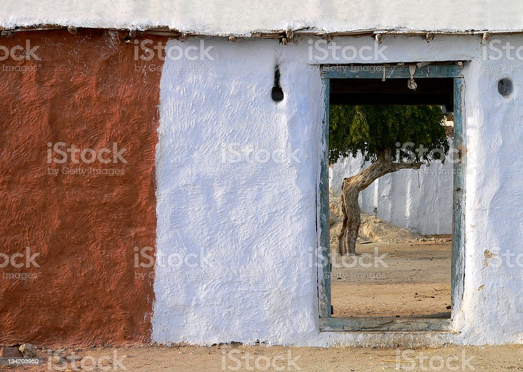 Traditional adobe house in desert village - Rajasthan, India royalty-free stock photo