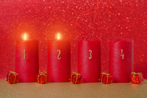traditional advent candles with numbers and gifts on red background traditional advent candles with numbers and gifts on red background, selective focus day 4 stock pictures, royalty-free photos & images