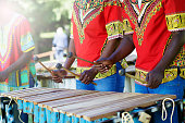 Traditional African Marimba players hands playing Wooden Xylophone Outdoors
