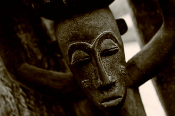 Traditional African wooden sculpture, closeup detail. stock photo