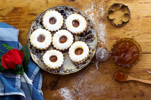 traditional algerian  linzer cookies with apricot jam on plate for holiday stock photo
