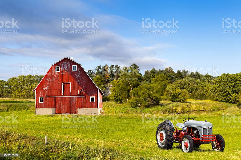 Traditional American Red Barn With Vintage Tractor stock photo