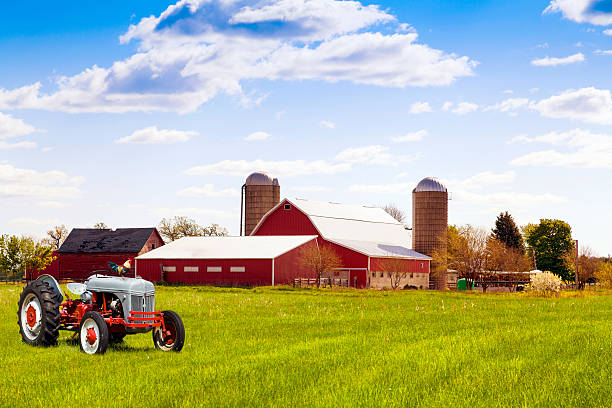 Traditional american red farm with tractor stock photo