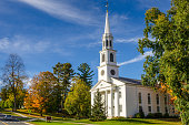 istock Traditional American White Church and Blue Sky 821257904