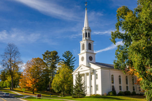 Traditional American White Church and Blue Sky Traditional American White Church with a high Steeple in Williamstown, MA, on a Clear Autumn Day place of worship stock pictures, royalty-free photos & images