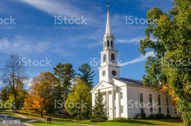 Traditional American White Church with a high Steeple in Williamstown, MA, on a Clear Autumn Day