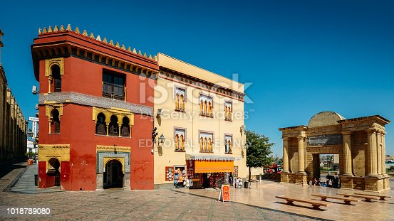 istock Traditional Analucian architecture with the Triumphal arch, Cordoba, Andalucia, Spain 1018789080