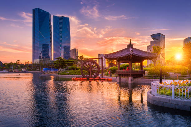 Traditional and modern architecture of seoul city in sunset, central park in songdo International business district, Incheon South Korea. stock photo