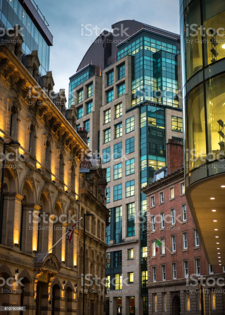 Traditional and modern city-centre architecture in Manchester at dusk stock photo