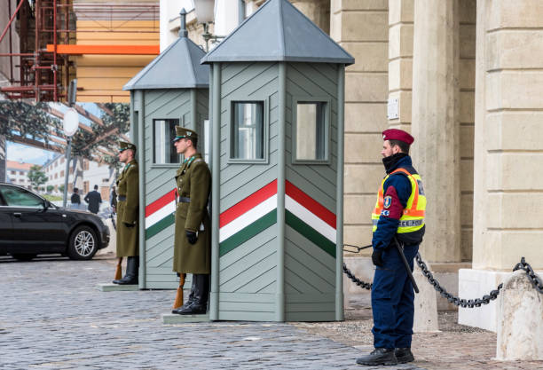 Traditional and modern security guards at Sándor Palace stock photo