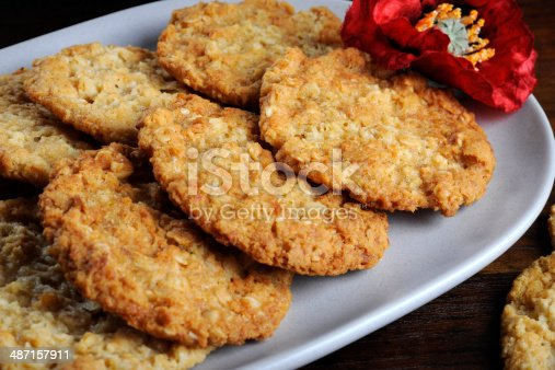 istock Traditional Anzac biscuits on dark recycled wood close up 487157911