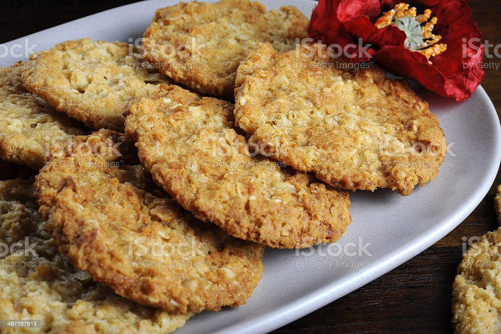 Traditional Anzac biscuits on dark recycled wood close up stock photo