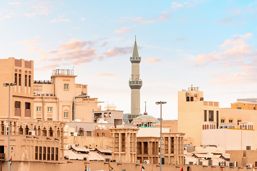 Traditional Arab houses and the towering minaret of the mosque in the neighborhood of Bur Dubai Creek and Golden Souk