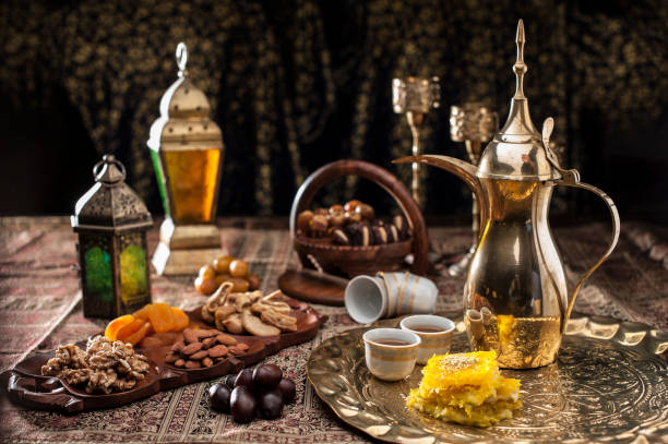 traditional arabian coffee, nuts and sweets - eid stock pictures, royalty-free photos & images