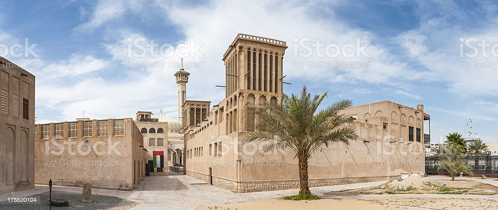 Traditional Arabic architecture windtowers minaret and mosque Dubai royalty-free stock photo