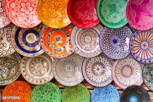 Traditional arabic handcrafted, colorful decorated plates shot at the market in Marrakesh, Morocco, Africa.