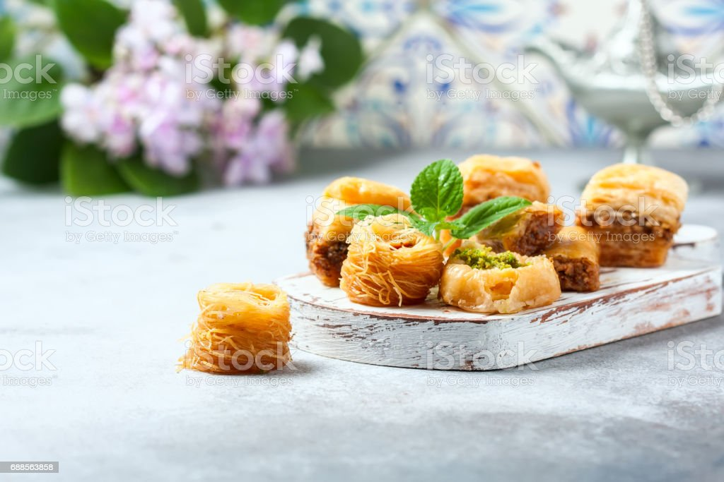 Traditional arabic dessert Baklava with honey and nuts, selective focus stock photo