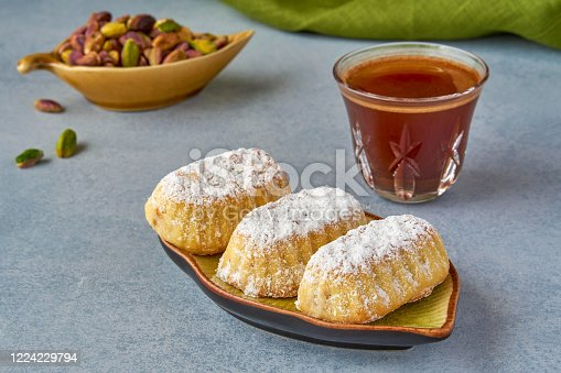 963384046 istock photo Traditional arabic eid sweets. Maamoul cookies with pistachio and coffee 1224229794