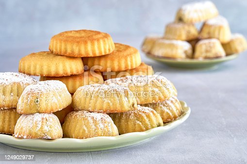 963384046 istock photo Traditional arabic eid sweets. Maamoul or mamoul cookies with pistachios and walnut . Close up 1249029737