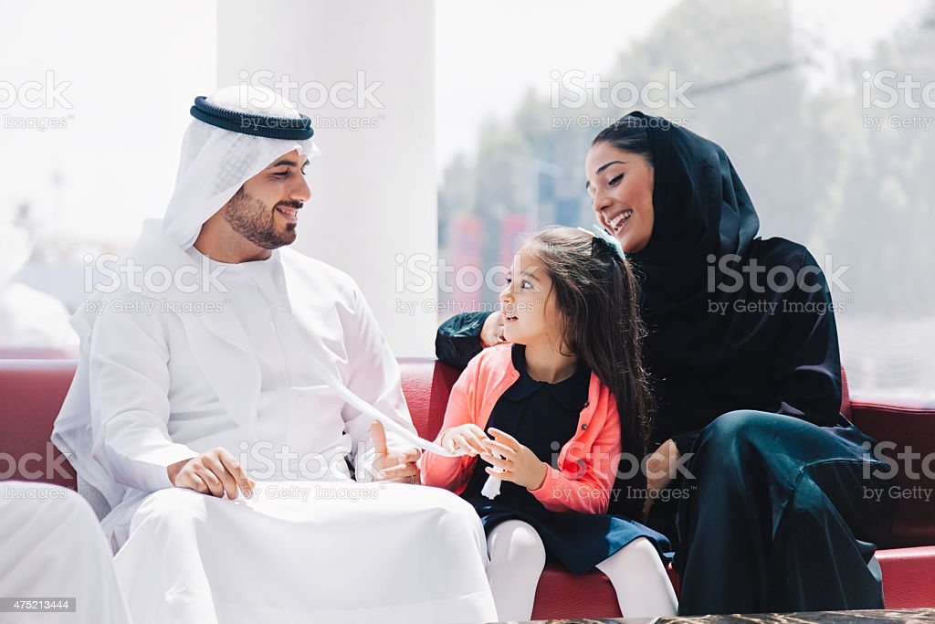 Traditional  Arabic family enjoying at lounge stok fotoğrafı
